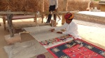 Roopraj Prajapati demonstrating the working of his loom
