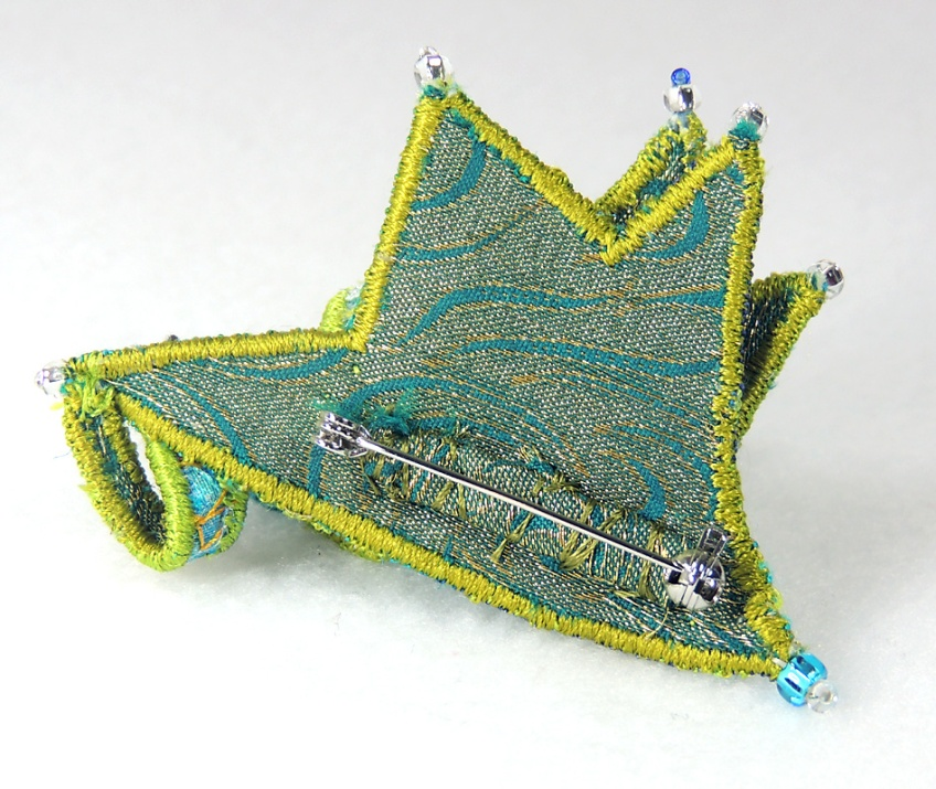 Back view of the green and blue brooch