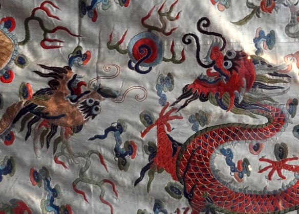Dragons chasing a flaming pearl (Taoist priest's robe, V&A museum)
