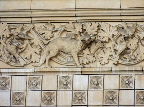 The building also has more subtle decoration, such as this fox and birds over the entrance