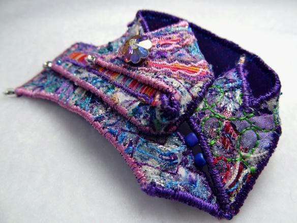 Pastel rainbow textile brooch by Wai-Yuk Kennedy